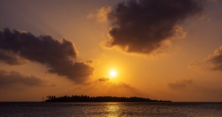 dramatic sunset sky above a tropical island in Maldives