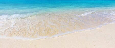 turquoise sea and soft waves surf on sandy beach, summer vacation on tropical island