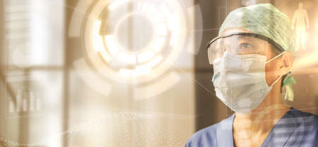 portrait of a female doctor wearing cap, glasses and protective mask looking at a transparent digital screen, concept of the future of medicine and medical technology