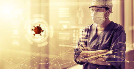 female physician with protective mask looks at a coronavirus hologram on a transparent screen, HUD style. Concept of pandemic viral infection care and research