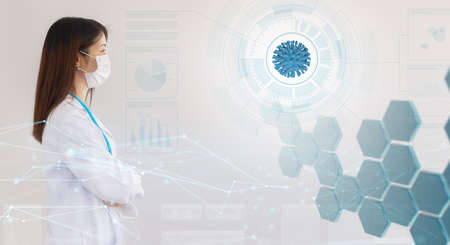 asian woman doctor looking at a coronavirus hologram in an abstract scientific background, concept of coronavirus vaccine research and medical care technology Standard-Bild