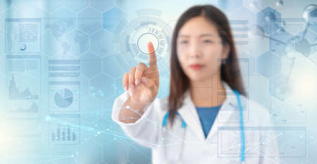 female doctor touches a digital transparent screen in hud style, modern technology in health care, abstract futuristic background Standard-Bild