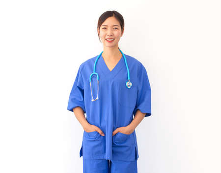 portrait of attractive young asian nurse wearing blue uniform and stethoscope isolated on white backgroound