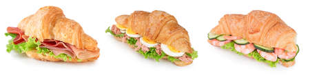 collection of croissant with parma ham, tuna, eggs, boiled shrimps and lettuce isolated on white