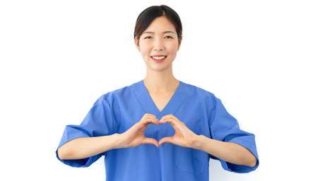 female doctor shows heart symbol with hands. Medicine people care and health concept
