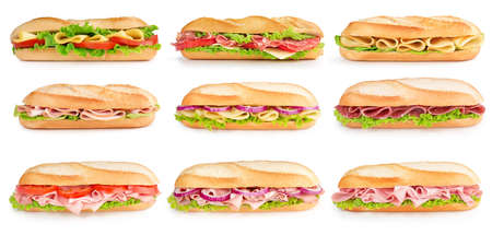 baguette filled with cheese, ham, salami, turkey, tomato and lettuce