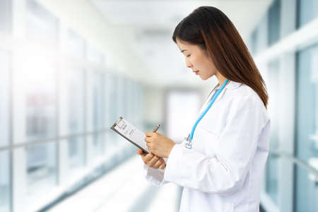 female doctor with lab coat and stethoscope at work