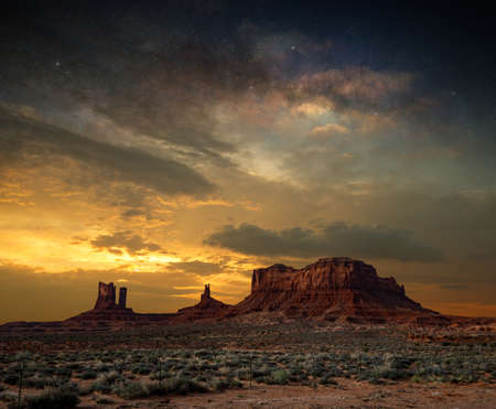 Dramatic twilight sky and majestic sandstone formations in Monument Valley National Park.