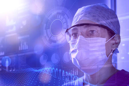 Female scientist wearing lab glasses and protective mask examines data on a transparent digital screen. Concept of innovative technology in medical research, HUD style Standard-Bild