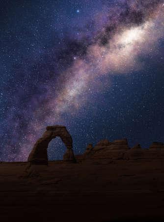 Delicate Arch under the Milky Way in a starry night sky. Arches National Park, Utah. Zdjęcie Seryjne
