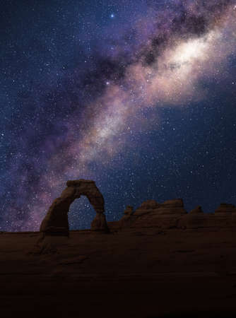 Delicate Arch under the Milky Way in a starry night sky. Arches National Park, Utah.