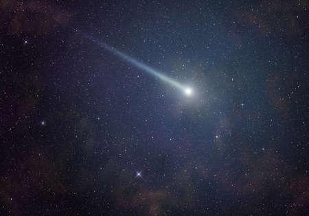 Shining comet in a starry night sky. Standard-Bild