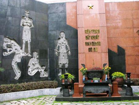 Hanoi, Vietnam, June 16, 2016: Memorial and mural in the courtyard of Hoa Lo Prison. Hanoi, Vietnam