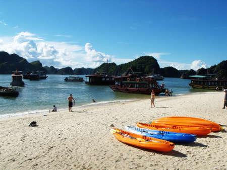 Ha Long Bay, Vietnam, June 23, 2016: Kayaks, boats and tourists on a beach on Monkey Island in Ha Long Bay. Vietnam