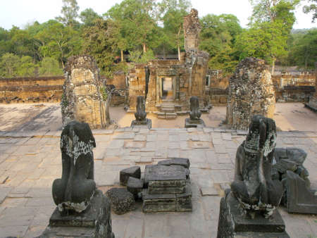 Siem Reap, Cambodia, April 8, 2016: Stone lions at the entrance of the East Baray temple in the Khmer temple complex of Angkor