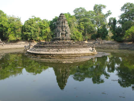 Siem Reap, Cambodia, April 8, 2016: Reflection in the water of one of the Neak Poun monuments in the Khmer temple complex of Angkor
