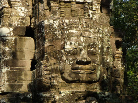 Siem Reap, Cambodia, April 8, 2016: Face sculpted in stone in the Khmer temple complex of Angkor
