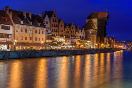 Old town of Gdansk with ancient crane at night. Poland, Europe. Stock Photo