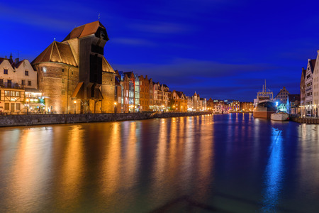 Beautiful Old town of Gdansk at night reflected in Motlawa river.  Poland, Europe. Stock Photo