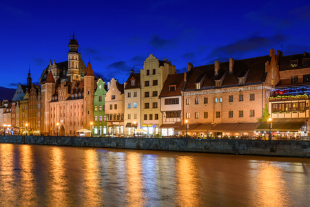 Old town and Motlawa river at night in Gdansk. Poland, Europe. Stock Photo