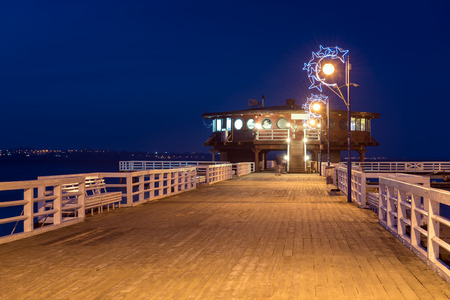 Illuminated pier in Puck at night. Baltic Sea, Poland.