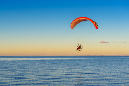 Flying paraglider over the Baltic sea. Rewa, Poland. Stock Photo