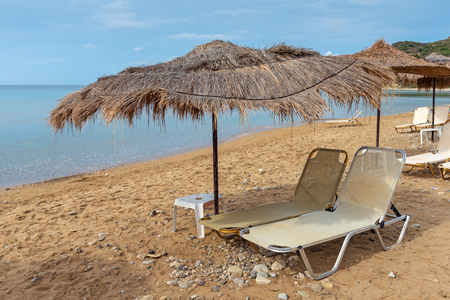 Sunbeds and parasols on beautiful Gerakas beach. Zakynthos island. Greece.