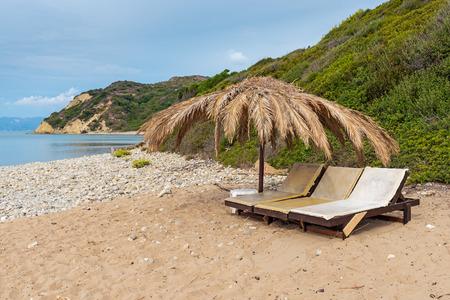 Sunbeds and parasol on beautiful Gerakas beach. Zakynthos island. Greece. Stock Photo