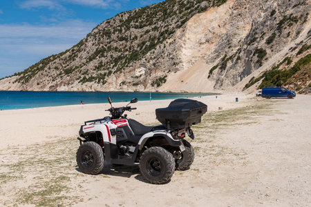 KEFALONIA, GREECE - September 30, 2017: Quad parked on the beach of Myrtos. Quad is very popular means of transport on Kefalonia island. Greece.