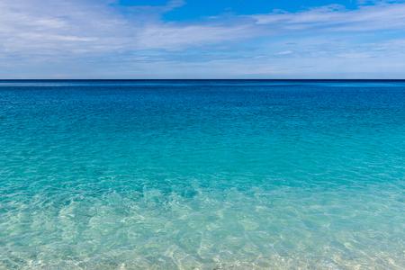 Crystal blue sea waters and blue sky. Myrtos beach on Kefalonia island. Greece Stock Photo