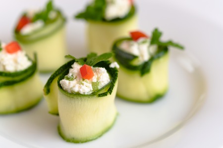 Rolls of zucchini stuffed with cheese and chives and red paprika. Banco de Imagens