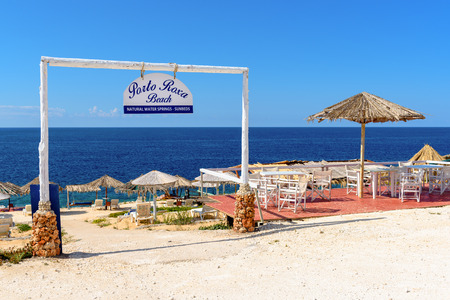 ZAKYNTHOS, GREECE - October 1, 2017: Sunbeds and parasols on Porto Roxa beach. Zakynthos island, Greece