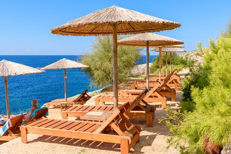 ZAKYNTHOS, GREECE: Sunbeds and umbrellas on Porto Limnionas beach on Zakynthos island, Greece