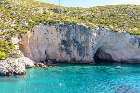 Blue waters and rocks of Porto Limnionas beach. Zakynthos island, Greece