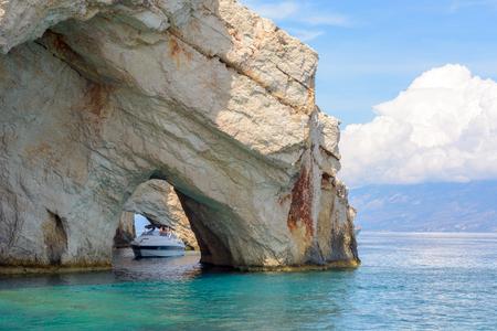 ZAKYNTHOS, GREECE, September 27, 2017: Cruise boat and famous Blue Caves. Zakynthos Island, Greece.