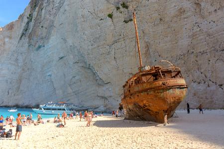 ZAKYNTHOS, GREECE, September 27, 2017: Tourists visit the famous Navagio Shipwreck beach in Zakynthos island Greece. Editorial