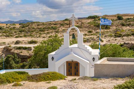 Traditional Greek whitewashed church in Agios Konstantinos on the island of Milos. Cyclades, Greece. Imagens