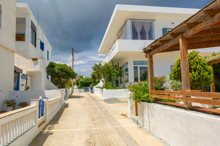 MILOS, GREECE - May 18, 2017: Street with typical Greek architecture of Pollonia village. Milos island, Greece