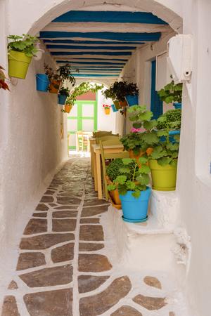 NAXOS, GREECE - May 20, 2017: Narrow street in Old town of Naxos, Naxos island, Greece