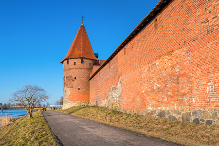 MALBORK, POLAND - April 2, 2018: Riverside promenade and towers of Malbork castle.Poland