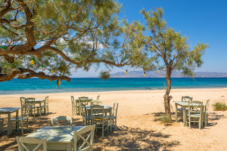 Romantic greek tavern on the Plaka beach. Naxos island, Greece.