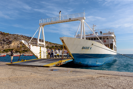 ZAKYNTHOS, GREECE - September 30, 2017: View of ferry waiting in port to be loaded with passengers and cars in sunny summer morning. Zakynthos island, Greece Redakční