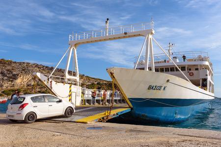 ZAKYNTHOS, GREECE - September 30, 2017: Vassos K, ferry waiting in port of St. Nikolaos to be loaded with cars in sunny summer morning. Zakynthos island, Greece Redakční