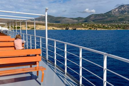 CEPHALONIA, GREECE - September 30, 2017: Cruise ship. Woman enjoying summer day on travel at sea