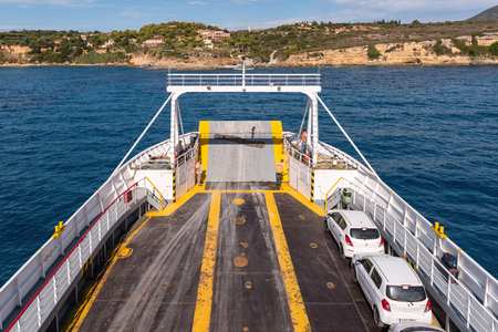 CEPHALONIA, GREECE - September 30, 2017: Cars parked on ferry. Coast of Kefalonia in background Editorial