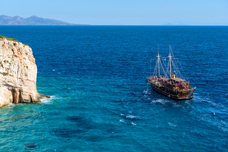 ZAKYNTHOS, GREECE - October 2, 2017: View of vintage ship on blue sea near Keri cape on Zakynthos island. Greece