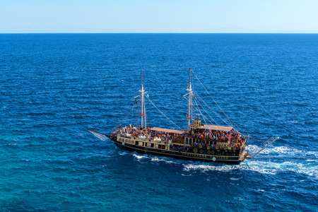 ZAKYNTHOS, GREECE - October 2, 2017: View of vintage ship on blue sea near Keri cape on Zakynthos island. Greece