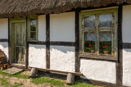 Window of wooden house in cultural open-air museum in Kluki village. Poland