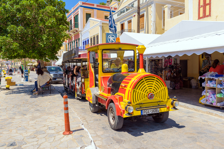 SYMI, GREECE - May 15, 2018: Sightseeing of the island from the train, local attraction on the island of Symi. Grece Banco de Imagens