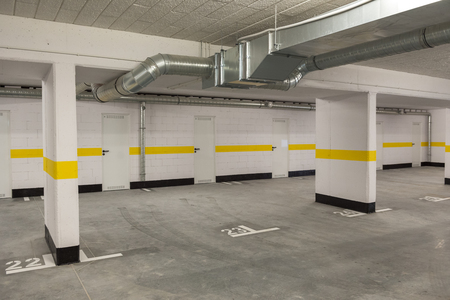 Typical underground car parking garage in a modern apartment house. Stock Photo